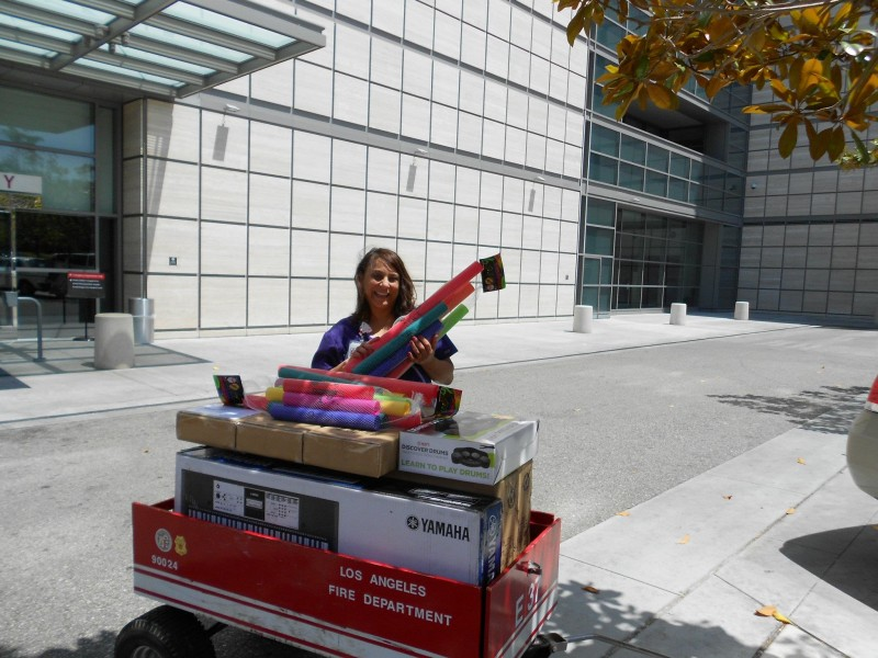 Mattel Child Life Program staff member with a wagon full of instruments!