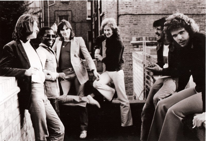 (L to R): Steve Winwood, Reebop Kwaku Baah, Chris Wood, Ric Grech, Jim Capaldi, and Unknown Person, circa 1974