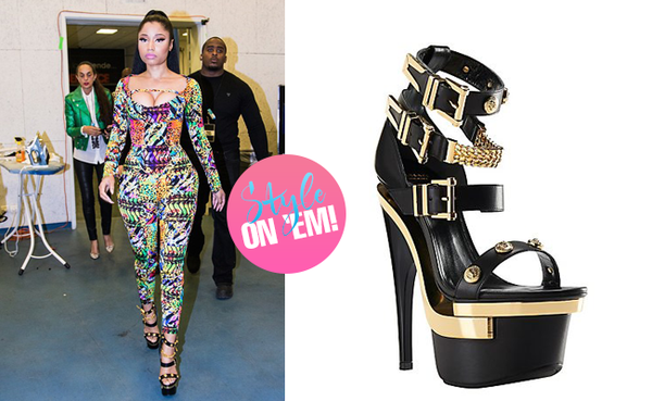 0a49ad4846e Nicki Minaj joined Beyonc onstage during the Paris stop of Bey and Jay-Zs  On the Run tour in a printed Versace jumpsuit. She completed the look with  a pair ...